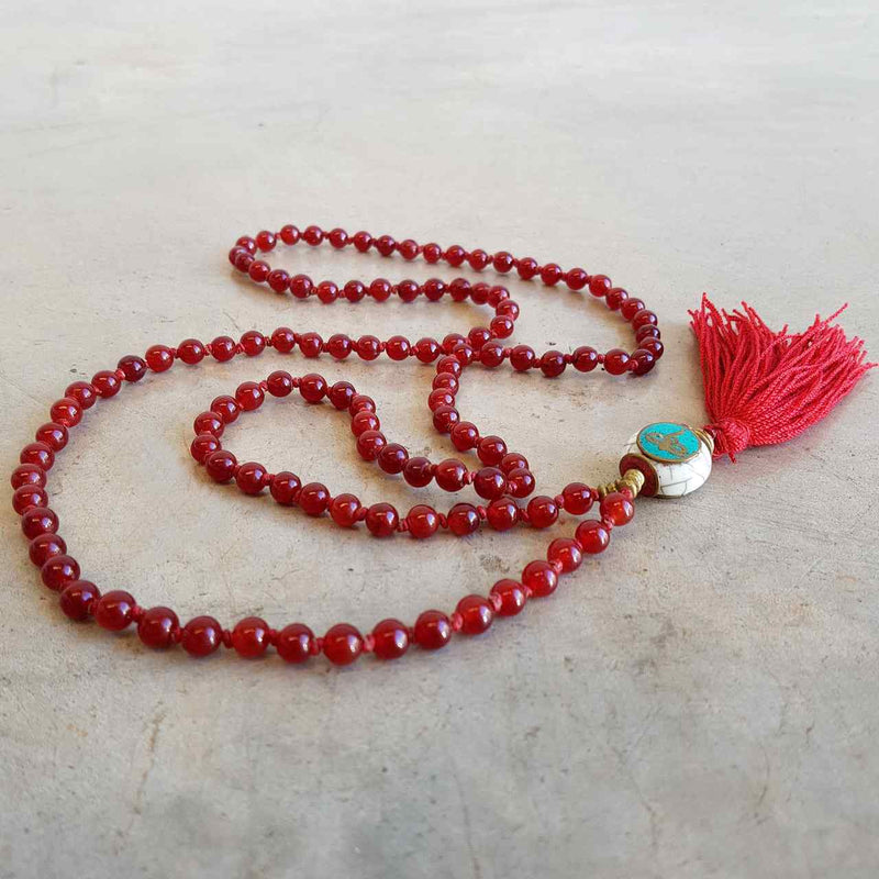 Gorgeous Shiawase hand-knotted stone tassel necklace. Deep Red stone