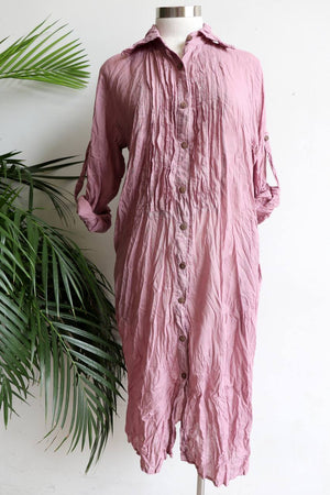Shirtmaker Beach Dress in 100% cotton with long sleeves, pockets and below the knee hemline. Lavender Pink.