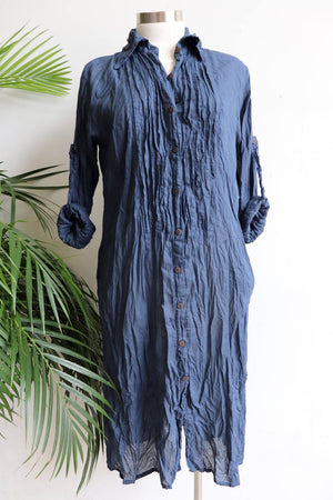 Shirtmaker Beach Dress in 100% cotton with long sleeves, pockets and below the knee hemline. Navy Blue