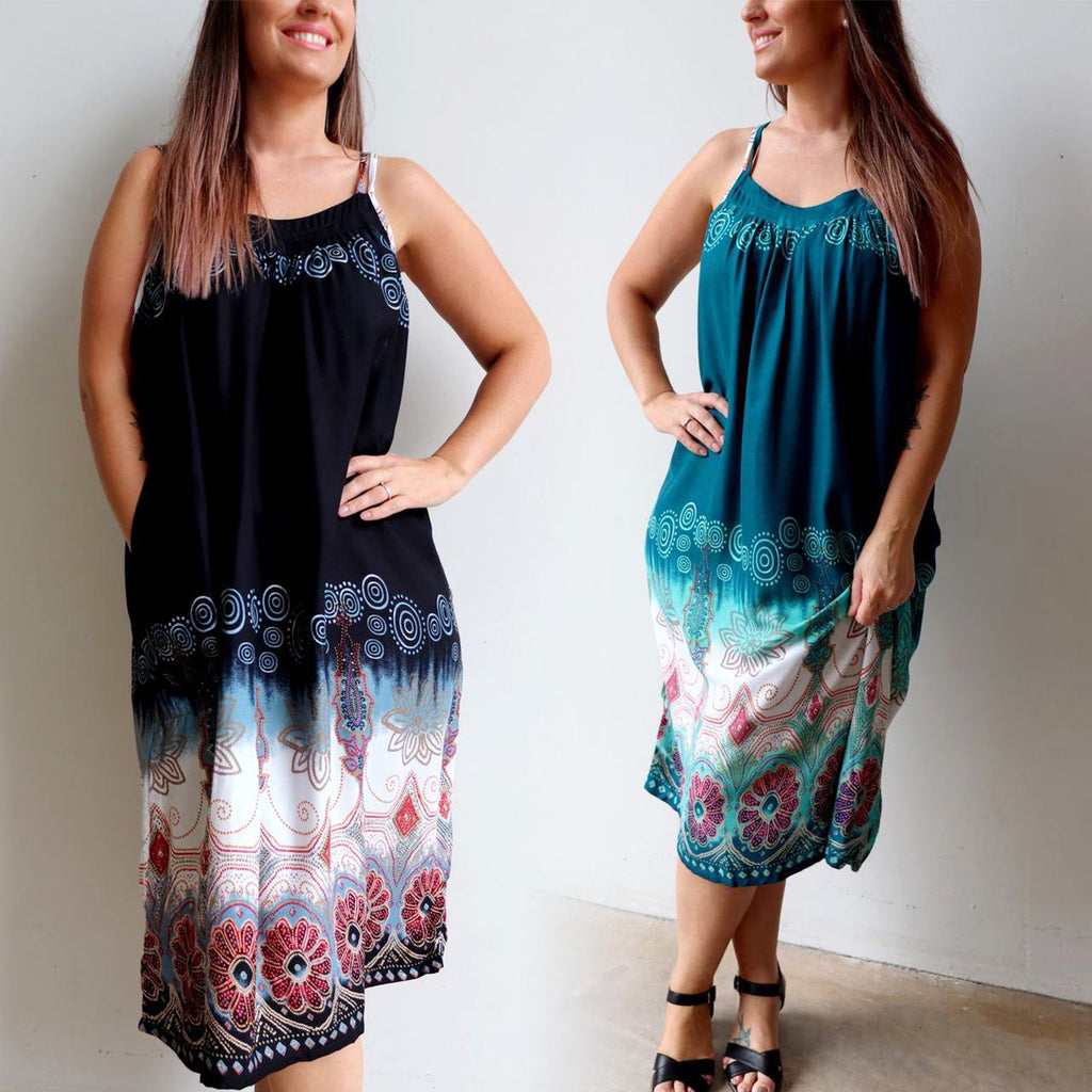 Long two-tone below-the-knee sun dress with swirl print. Onesize Summer dress with shoestring straps, easily fits plus sizes 10-20. Black, navy blue, turquoise blue and teal green available.