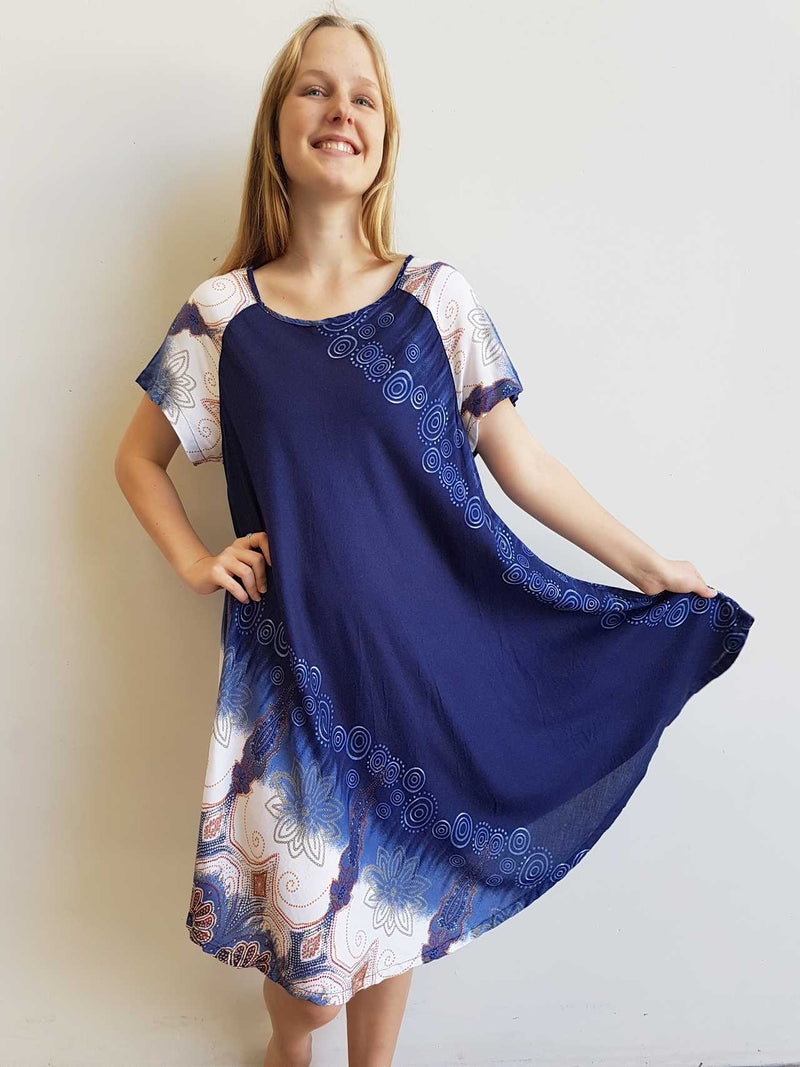 Short Sleeve two-toned rayon tunic dress. Free-flowing with round neck and Scalloped Hem. Onesize, fits 10 - 18 plus.