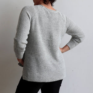 Sideline Knit Sweater is a classic women's winter crew neck jumper with chic button detail. Oatmeal. Back View.