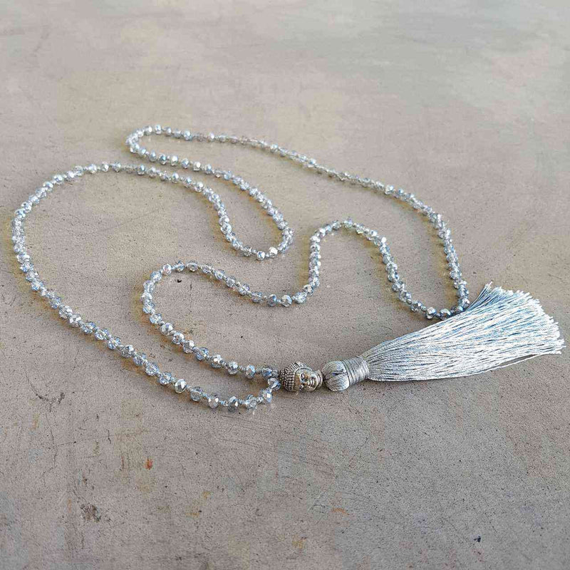 Glass faceted beads with metallic finish. Silver plated Buddha bead charm at centre with long, silky soft tassel. SILVER