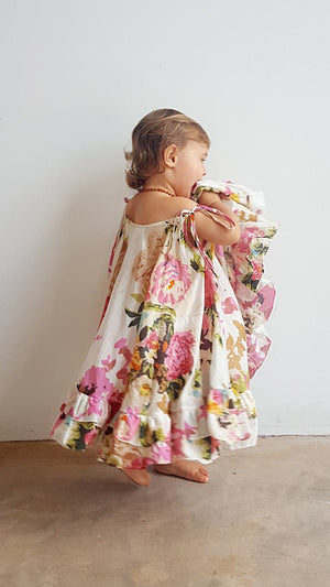 Summer girls dress with ruffled, full-skirted design ethically handmade in sizes baby to tween.