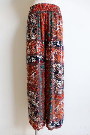 Elegant and versatile wrap pant, with a wide waistband comfortably elasticised around the back and a neat flat front finish. Made with soft, textured rayon & designed in a spicy caramel, emerald, rust, berry & navy print. Sizes 8 to 18.