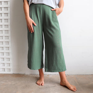 Stradbroke Pants 3/4 length wide-leg women's pants. Made with neat front pleats, two side pockets & elasticated at back of waistband for comfort. Easy care linen/viscose fabric blend. True to fit sizing, available in 8-18. Sage.