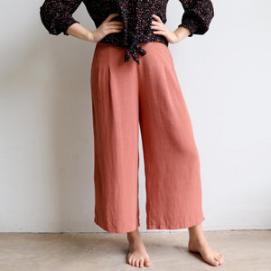 Stradbroke Pants 3/4 length wide-leg women's pants. Made with neat front pleats, two side pockets & elasticated at back of waistband for comfort. Easy care linen/viscose fabric blend. True to fit sizing, available in 8-18. Rose.