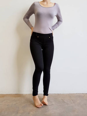 Stretch leggings made from cotton + spandex. A comfortable full length pant for the winter completed with belt loops and pockets.  Black.