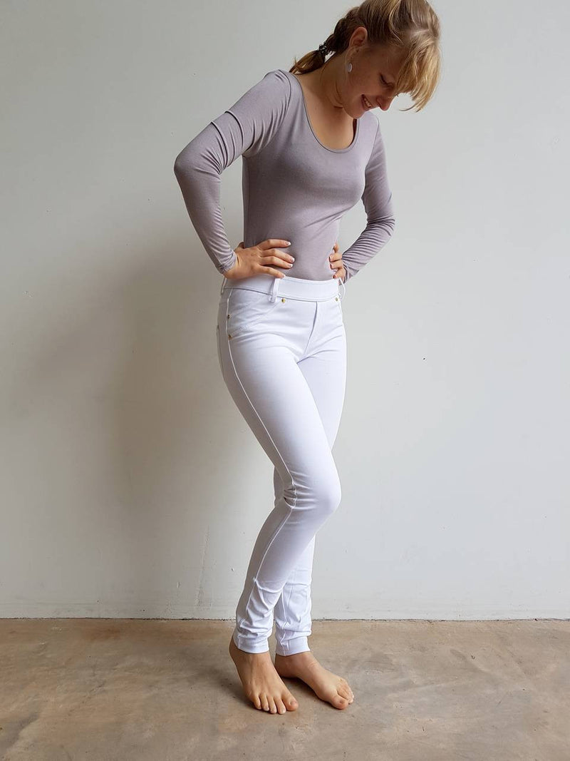 Stretch leggings made from cotton + spandex. A comfortable full length pant for the winter completed with belt loops and pockets.  White.