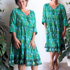Summer Holiday Dress in tropical emerald green. Below-the-knee and with 3/4 sleeves this is a cotton summer dress that will keep you cool and covered.