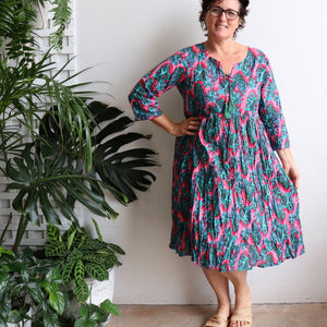 Summer Holiday Dress in tropical palm print. Below-the-knee and with 3/4 sleeves this is a cotton summer dress that will keep you cool and covered.