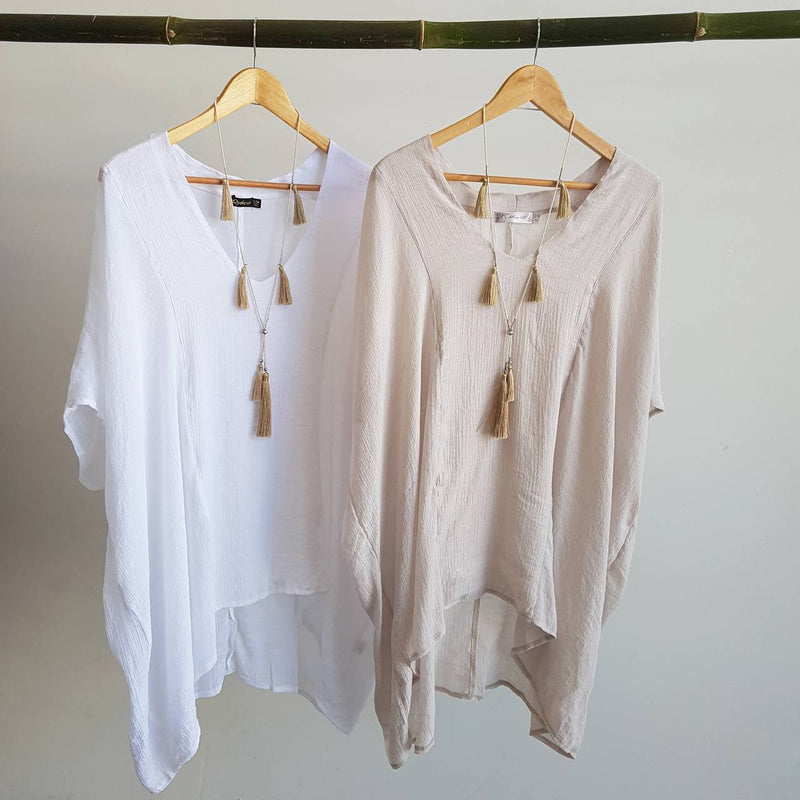Plus size light + floaty long neutral Summer beach kaftan top with V-neck and elbow-length sleeves. Moonshine & White.