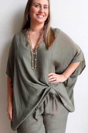 Plus size light + floaty long neutral Summer beach kaftan top with V-neck and elbow-length sleeves. Eucalyptus Green.