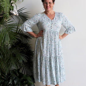 Women's 3/4 sleeve Midi Summer Dress in a classic pastel blue floral print. Made from 100% soft rayon fabric in sizes 12-18.
