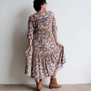 Our Sunday Best Midi Dress is flowing floral frock in a long, classic boho style. Back view.