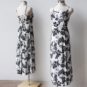Sunset Sun Dress with criss-cross tie back. Plus-size women's summer dress in a floral print. Available in Black, white or navy.