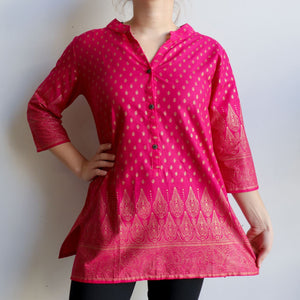 Sunshine Kurta Tunic manufactured in a striking temple themed patterned print. Ethically handmade + produced in lightweight cotton with a mid-length sleeve. Available in sizes S-XXXL. Pink.