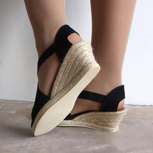 Women's slip-on Summer Wedge Sandal. Made in Spain for Diana Ferrari, available in Black + Taupe.