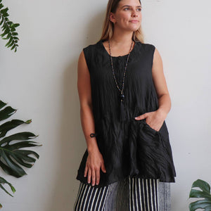 Take It Easy women's button-through sleeveless tunic top. Perfect summer travel shirt made from 100% cotton with handy side pockets. Sizes S/M-L/XL. Black.