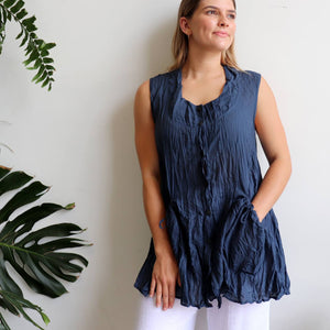 Take It Easy women's button-through sleeveless tunic top. Perfect summer travel shirt made from 100% cotton with handy side pockets. Sizes S/M-L/XL. Navy.