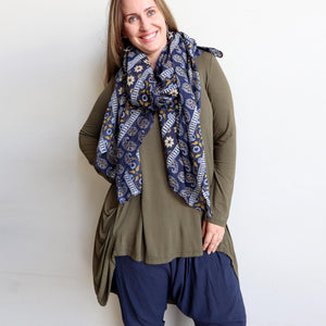 Made with 100% cotton voile fabric, a feminine and floaty oversized scarf. An eye catching traditional print that can also be worn as a beach sarong. Indigo Blue.