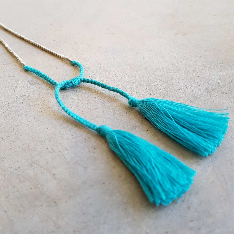 Silver and Blue metallic bead necklace with tassel.