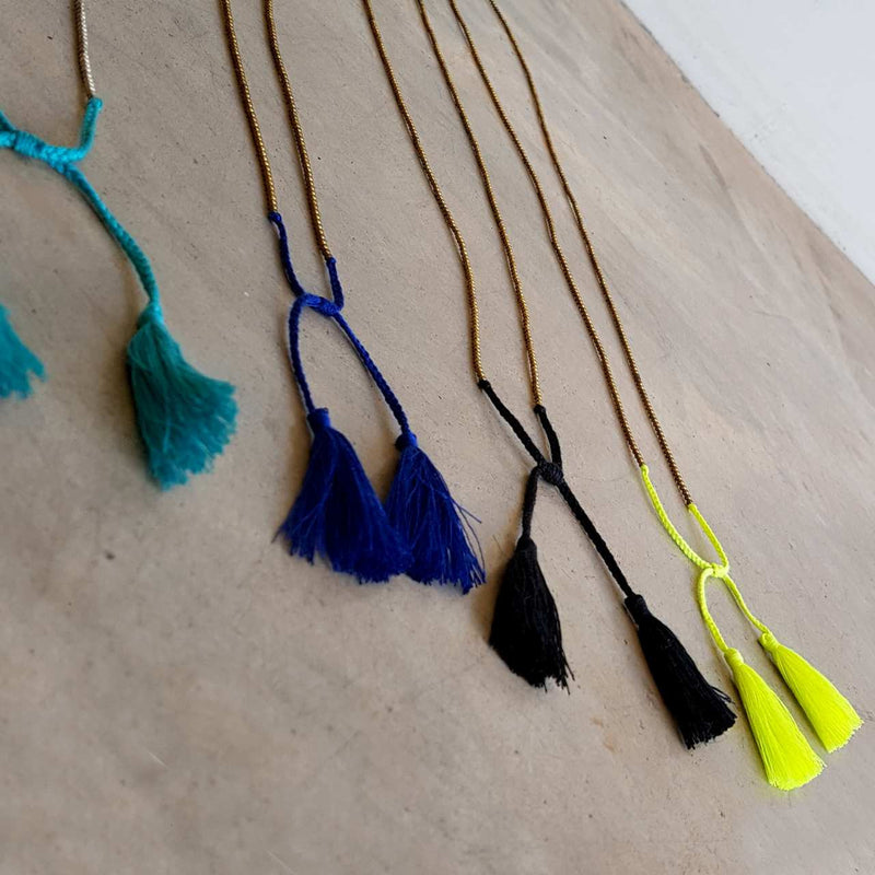 metallic bead necklace with tassel.
