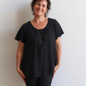 Tea Tree Top is a short sleeve summer blouse in a loose, easy style. Available in sizes 10 to 22. Black.