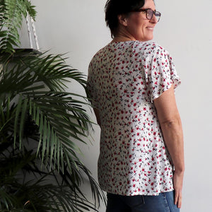 Tea Tree Blouse in Climbing Rose print is a cool summer peasant-style top. Back view.