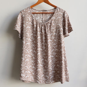 Classic peasant style blouse with short sleeve in pretty floral print. Plus size summer style. Mocha.