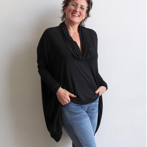 Our Glider Poncho Tee made in bamboo is a cowl neck plus size winter kaftan top. Black and denim.