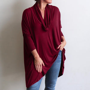 Our Glider Poncho Tee made in bamboo is a cowl neck plus size winter kaftan top. Sangria..