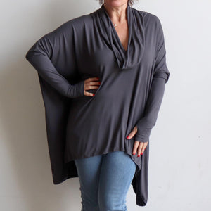 Our Glider Poncho Tee made in bamboo is a cowl neck plus size winter kaftan top. Charcoal Grey.