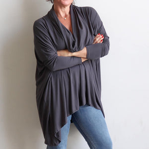 Our Glider Poncho Tee made in bamboo is a cowl neck plus size winter kaftan top. Charcoal grey. Arms view.