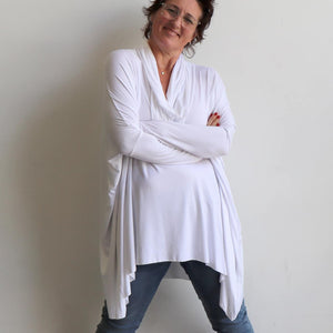 Our Glider Poncho Tee made in bamboo is a cowl neck plus size winter kaftan top. White. Crossed arms.