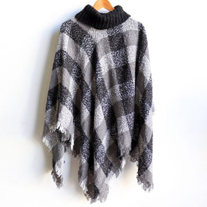Warm winter Poncho, thick and soft roll-neck top. Easy throw on, in a classic patterned print. Made with no itch acrylic. Essential Black.
