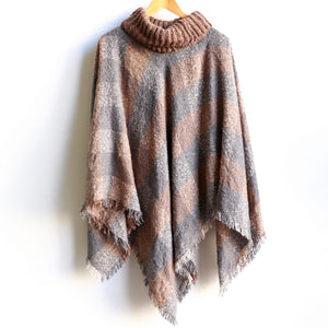 Warm winter Poncho, thick and soft roll-neck top. Easy throw on, in a classic patterned print. Made with no itch acrylic. Mocha.