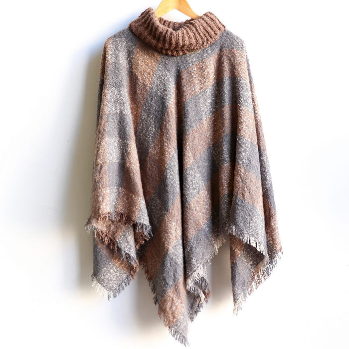 The Highlander Poncho - Criss Cross