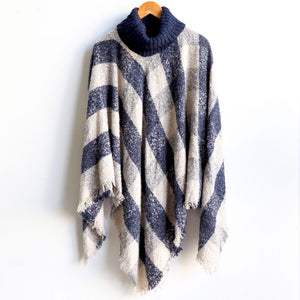 Warm winter Poncho, thick and soft roll-neck top. Easy throw on, in a classic patterned print. Made with no itch acrylic. Navy Blue.