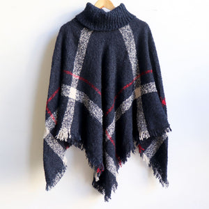 Warm winter women's Poncho, with thick and soft roll-neck top. Easy throw on knit, in a classic striped print. Made with no itch acrylic. Midnight Blue.