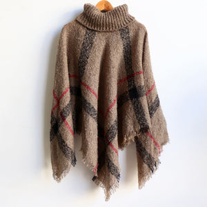 Warm winter women's Poncho, with thick and soft roll-neck top. Easy throw on knit, in a classic striped print. Made with no itch acrylic. Mushroom.