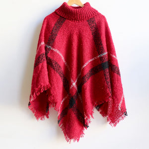 Warm winter women's Poncho, with thick and soft roll-neck top. Easy throw on one-size knit, in a classic striped print. Made with no itch acrylic. Ruby Red.