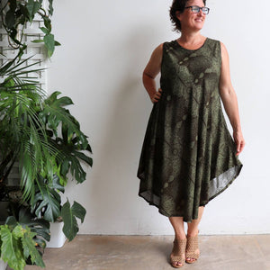 Women's sleeveless, below the knee midi dress in a stunning mystic print. Flirty summer frock made from cool, comfortable and easy care rayon. One size fit for sizes 10-16+.Khaki.