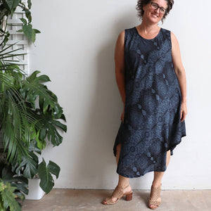 Women's sleeveless, below the knee midi dress in a stunning mystic print. Flirty summer frock made from cool, comfortable and easy care rayon. One size fit for sizes 10-16+. Midnight Blue.
