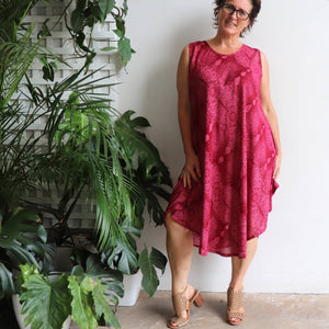 Women's sleeveless, below the knee midi dress in a stunning mystic print. Flirty summer frock made from cool, comfortable and easy care rayon. One size fit for sizes 10-16+. Red.