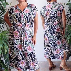 Ladies collared, short cuffed sleeved, button-up, midi, shirt dress with a waist tie in a fresh floral print for spring to summer wear. Super soft draping 100% rayon fabric with a relaxed and generous fit to suit petite to plus sizes up to 22.