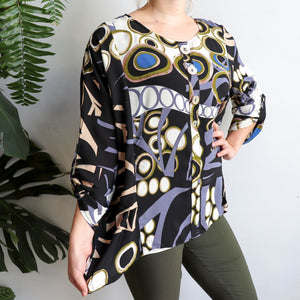 A comfortable women's blouse top with stylish button feature and 3/4 sleeves. Made with easy-care rayon fabric. Sizes 8-12. Black.