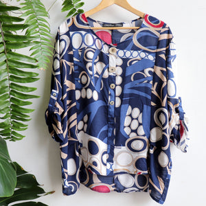 A comfortable women's blouse top with stylish button feature and 3/4 sleeves. Made with easy-care rayon fabric. Sizes 8-12. Navy Blue.