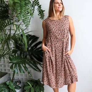Torquay Dress designed to be loose and flowing with below the knee hemline + a-line cut. Women's summer dress in a rose print fabric with button feature and pockets. Made from lightly textured quality rayon in sizes 8-20. Dusk.