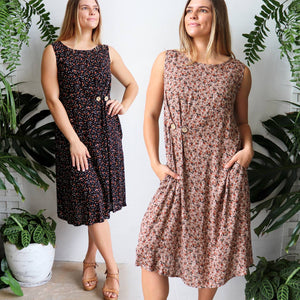 Torquay Dress designed to be loose and flowing with below the knee hemline + a-line cut. Women's summer dress in a rose print fabric with button feature and pockets. Made from lightly textured quality rayon in sizes 8-20.